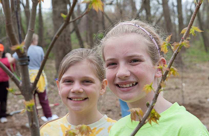 girls planting trees Howard County Maryland